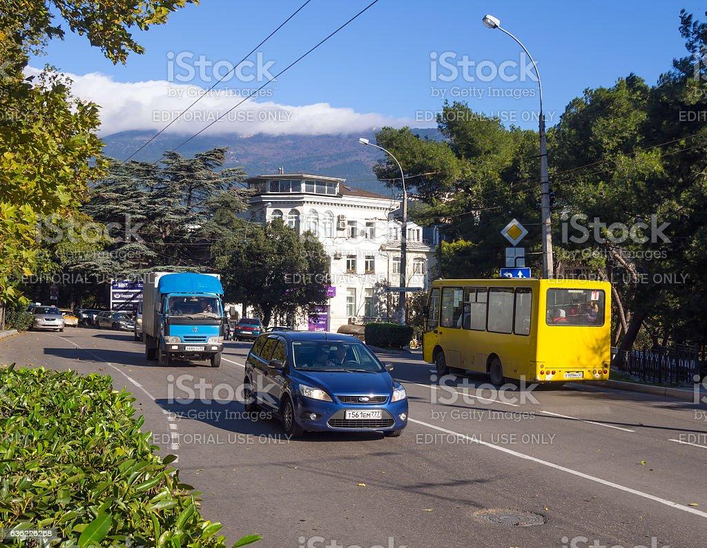 Car transport is going on Sadovaya street of Yalta stock photo