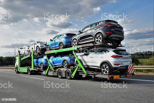 Berlin, Germany - September 20th, 2016: Kassbohrer car transporter driving on the highway. This car transporter has 7 Hyundai Tucson (from Czech factory) cars on board. The Kassbohrer car transporters are the ones of the most popular transporters in Europe.