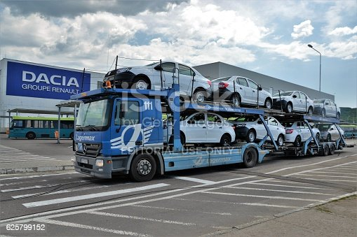 istock Car transporter driving on the street 625799152