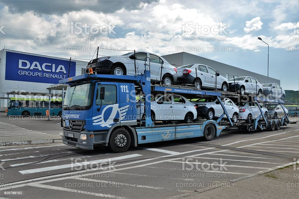 Car transporter driving on the street stock photo