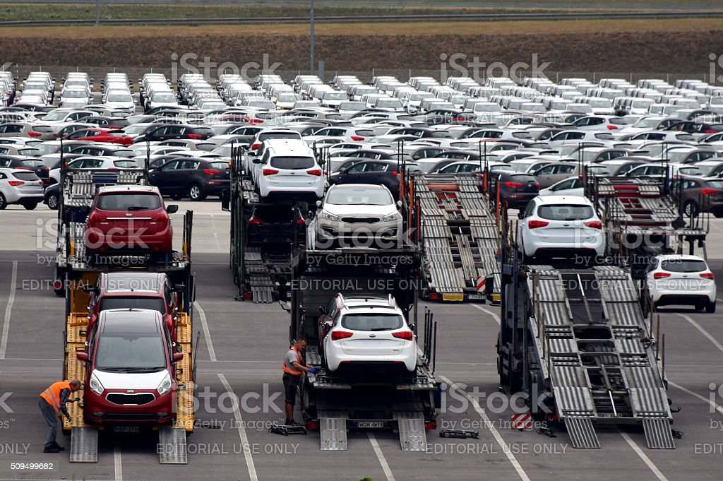 Car transporter lorries on the car factory parking stock photo