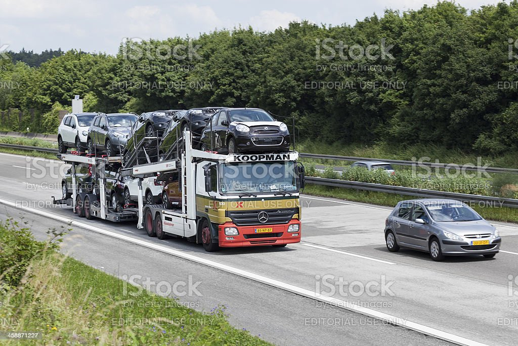 Car transporter on german highway royalty-free stock photo