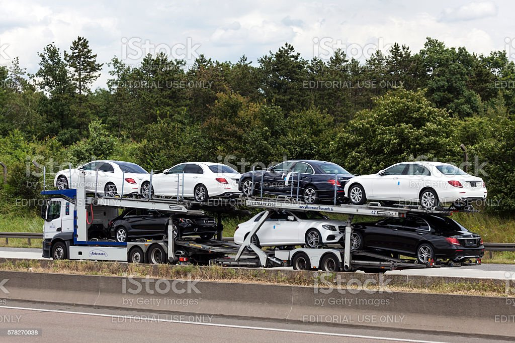 Car transporter on the highway stock photo