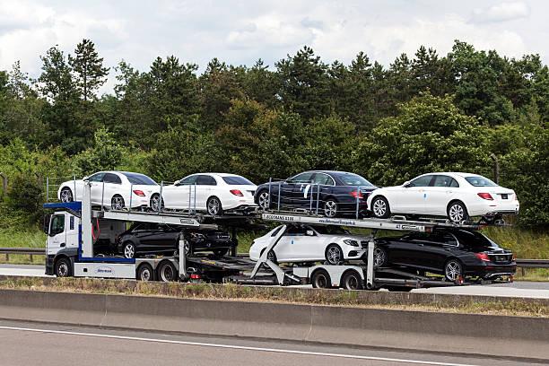 car transporter on the highway - autotransporter stock-fotos und bilder