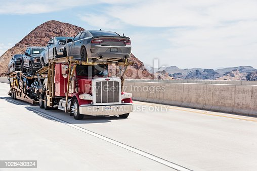 Car carrier on the Mike O'Callaghan–Pat Tillman Memorial Bridge. This bridge is bypass highway at Hoover Dam.
