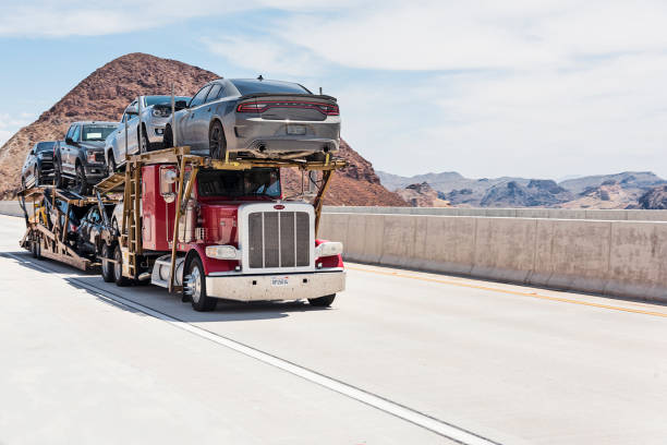 Car Transporter Car carrier on the Mike O'Callaghan–Pat Tillman Memorial Bridge. This bridge is bypass highway at Hoover Dam. carrying stock pictures, royalty-free photos & images