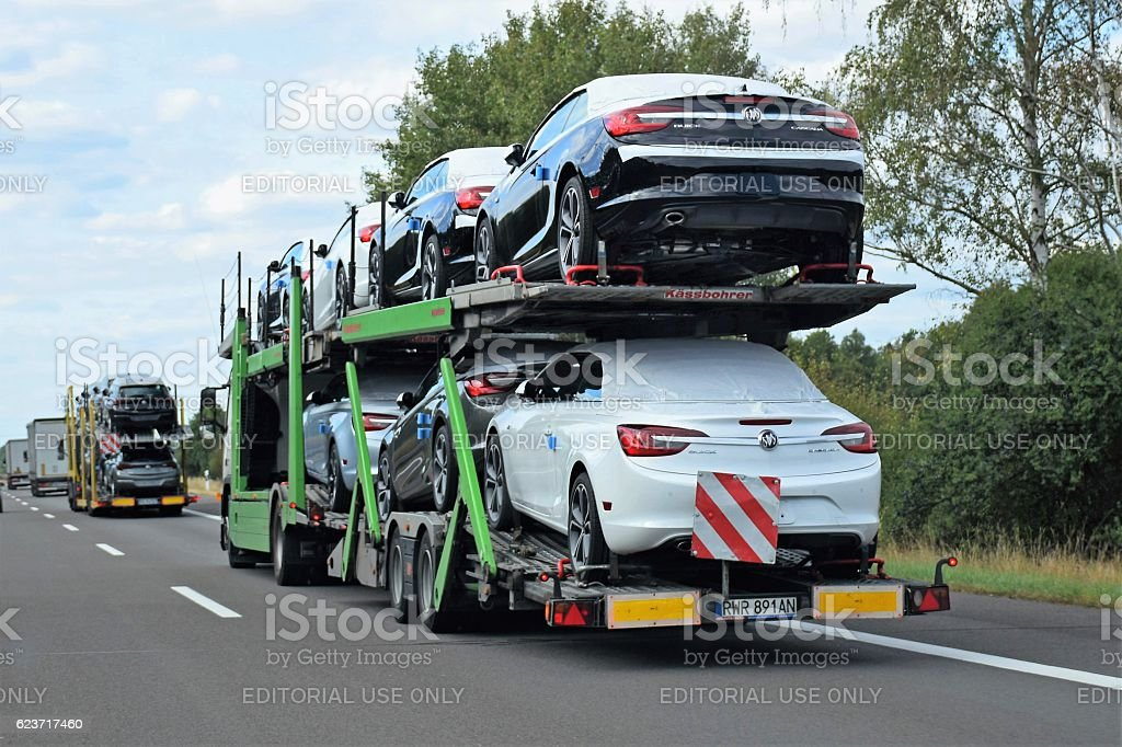 Car transporters driving on the highway stock photo