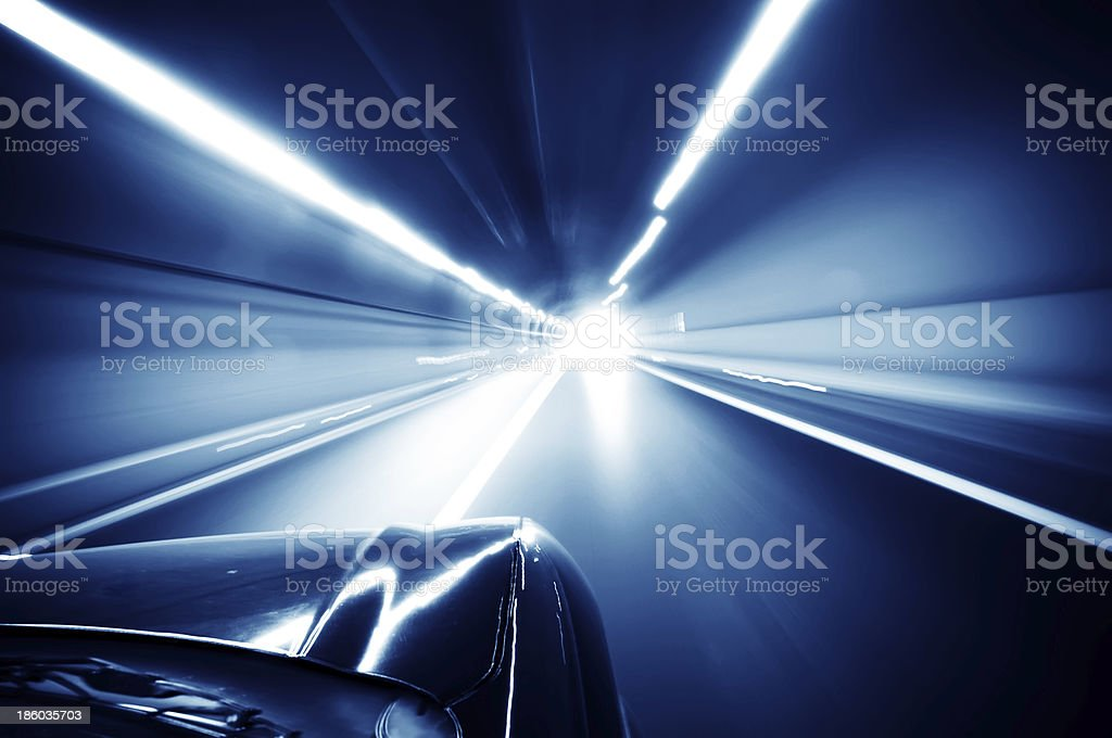 Car traveling in the tunnel stock photo