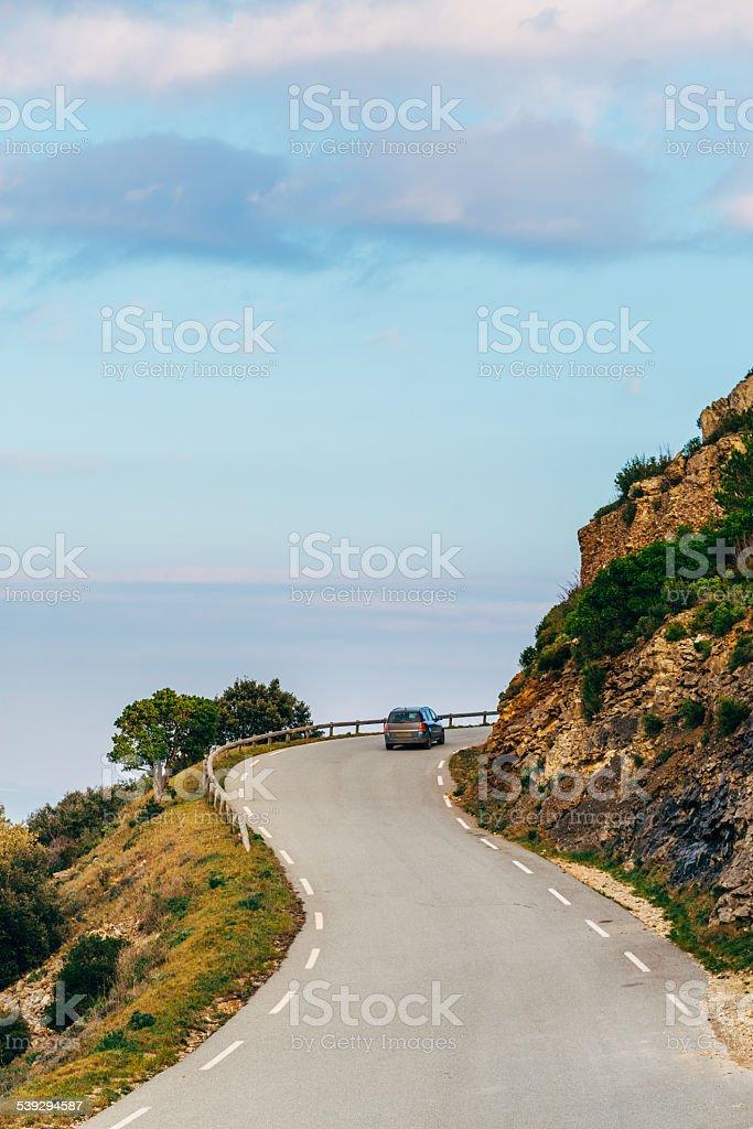 Car traveling on the sea coast stock photo