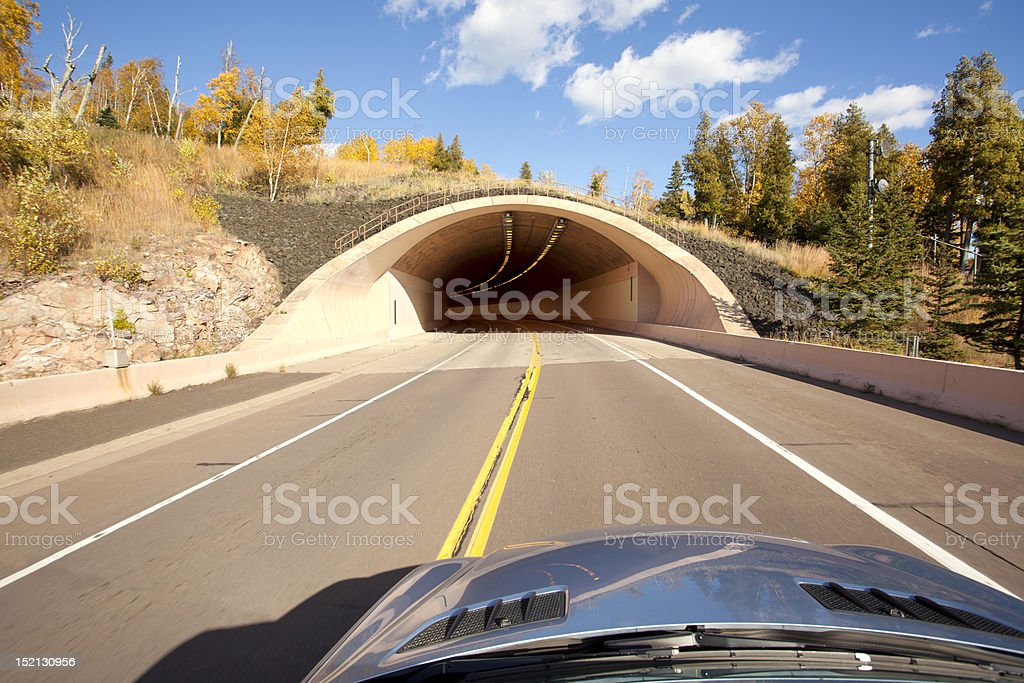 Car traveling to a road  tunnel in Autumn royalty-free stock photo