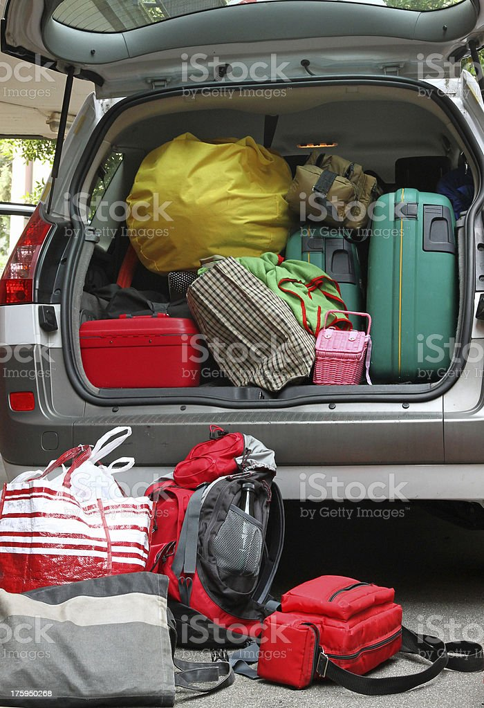 A car trunk full of luggage bags stock photo