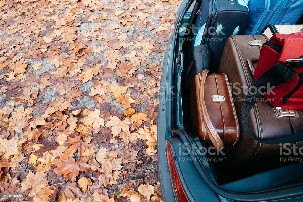 Car trunk loaded with suitcases. stock photo