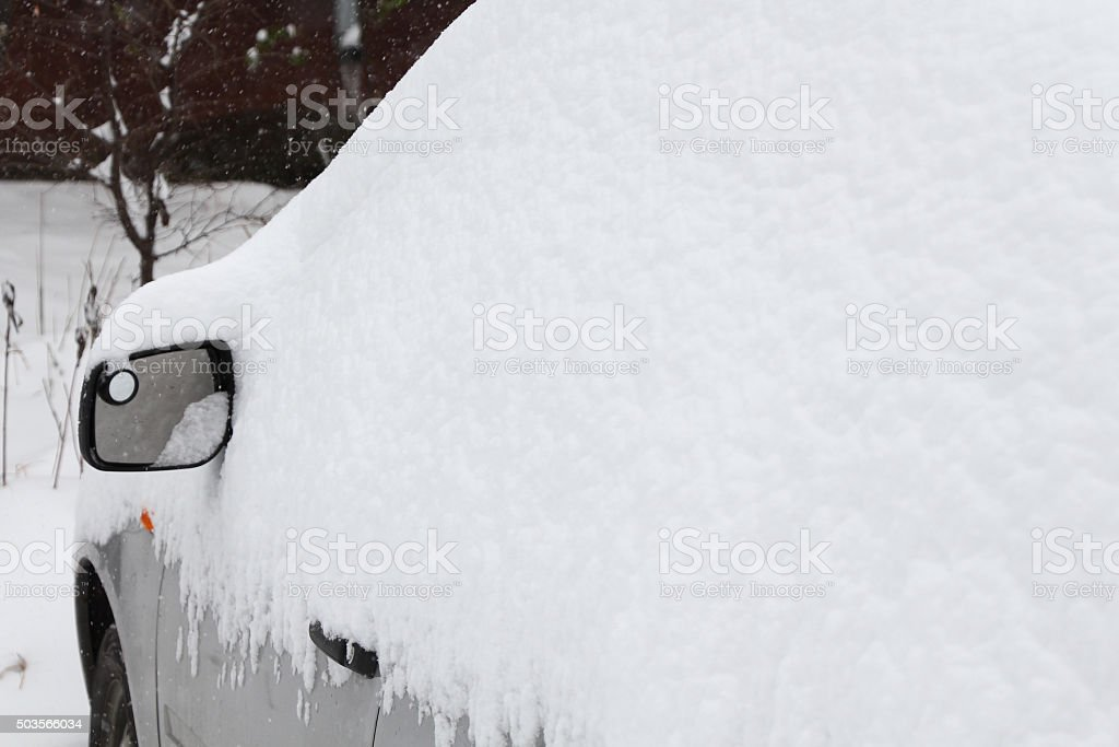 car under a snowdrift stock photo