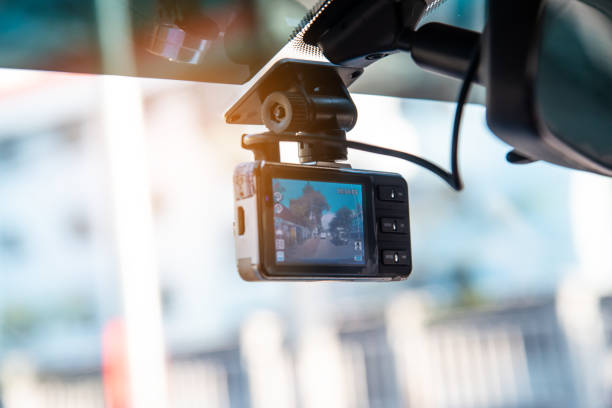 Car video camera attached to the windshield to record driving and prevent danger from driving Car video camera attached to the windshield to record driving and prevent danger from driving analogue audio storage media stock pictures, royalty-free photos & images