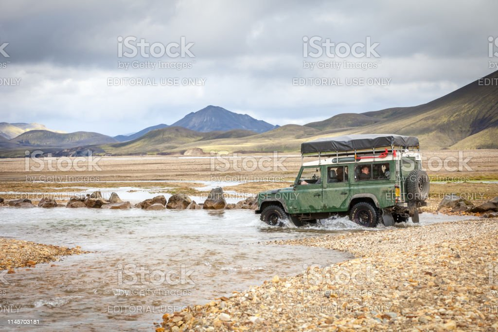 4WD car wades river, Iceland stock photo