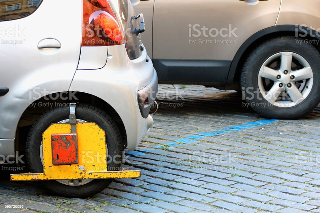Car was locked with clamped vehicle, wheel lock. stock photo