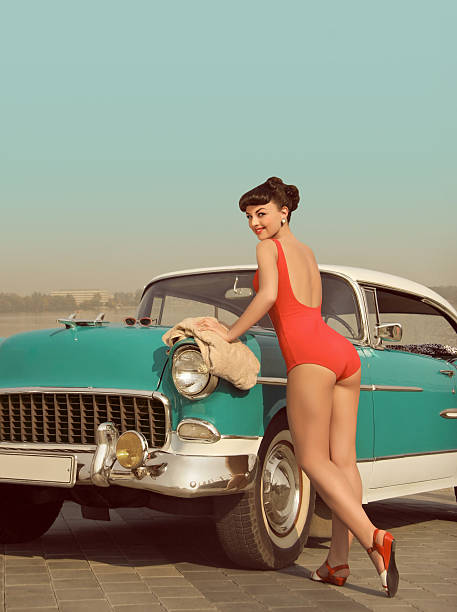 car wash girl - pin up girl stock pictures, royalty-free photos & images