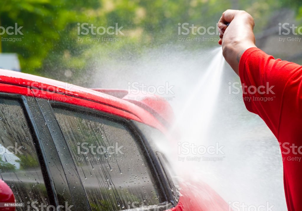 car wash with flowing water and foam. stock photo