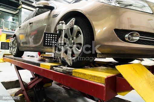 154934986 istock photo Car wheel alignment 898633472