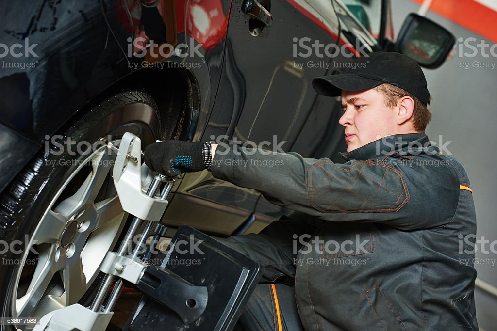 car wheel alignment service work stock photo