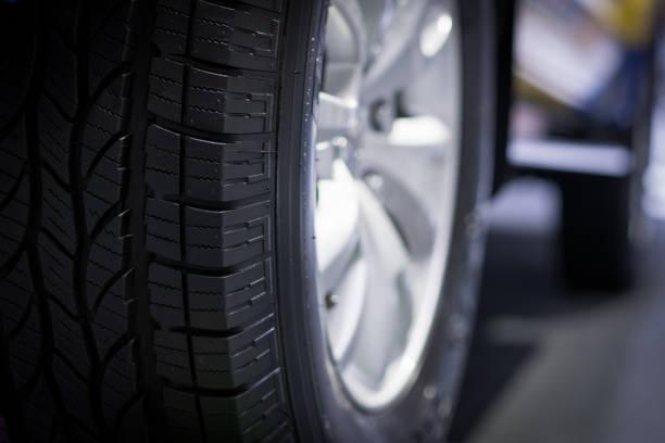 Car wheel closeup, blur background stock photo
