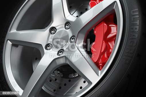 istock Car wheel red brakes closeup 693803562