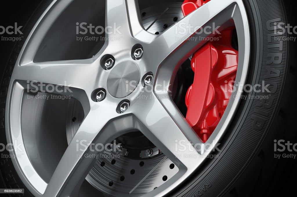 Car wheel red brakes closeup stock photo