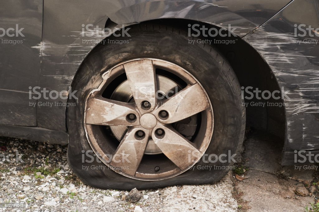 car wheel ruined after an accident stock photo