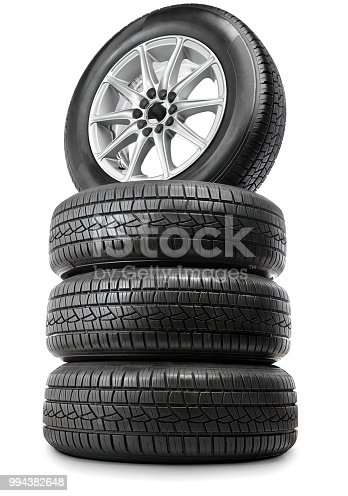 Set of four car wheels and tires.  Isolated on white.