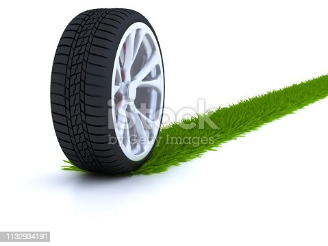 Car wheel with grass trail isolated in white background