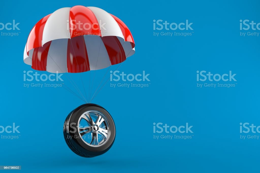 Car wheel with parachute royalty-free stock photo