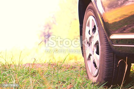 639525926 istock photo Car wheel with summer tire on green grass 1080780930
