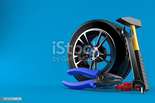 istock Car wheel with work tools 1015206628