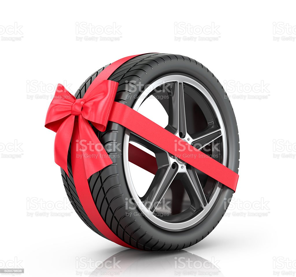 Car wheel wrap a red ribbon with a bow stock photo