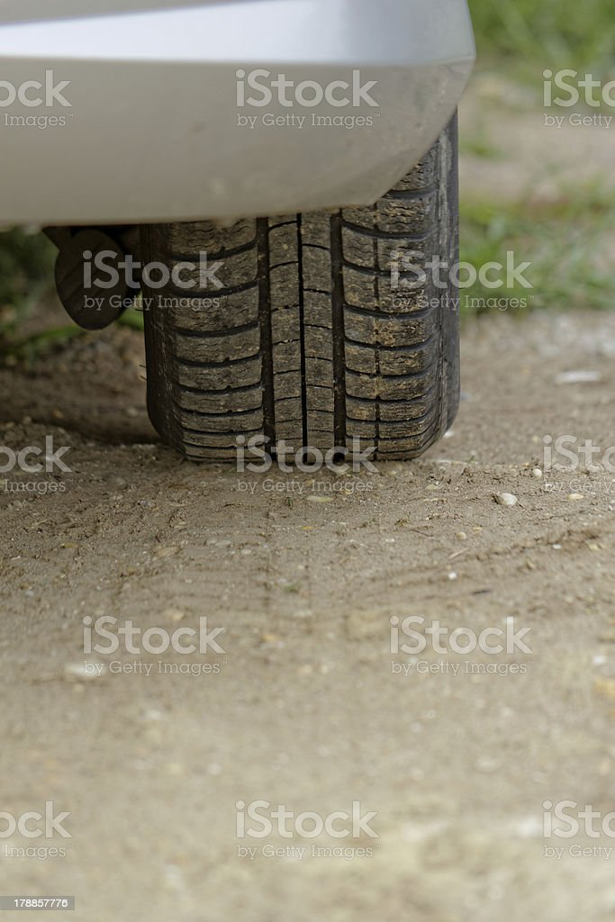 Car wheels on a dusty road detail royalty-free stock photo