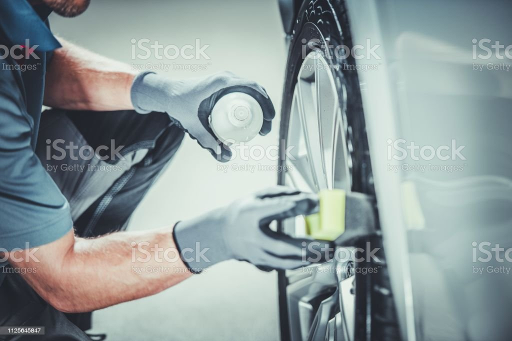 Car Wheels Pro Cleaning Car Wheels Pro Cleaning Using Professional Detergents. Vehicle Detailed Clean. Alloy Wheel Stock Photo