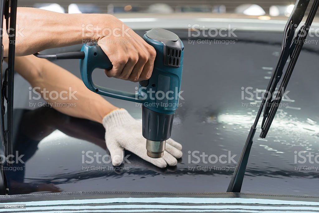 Car window tinting series : Heat shrinking window film stock photo