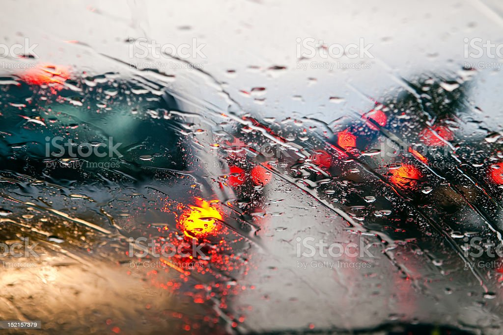 Car windshield in traffic jam during rain stock photo
