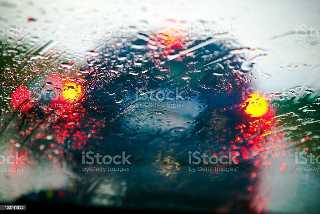 Car windshield in traffic jam during rain royalty-free stock photo