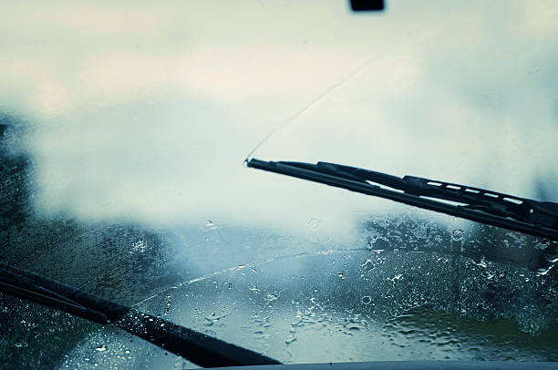 Car windshield wipers. Car windshield wipers in the rainy weather. traffic jam. windshield wiper stock pictures, royalty-free photos & images