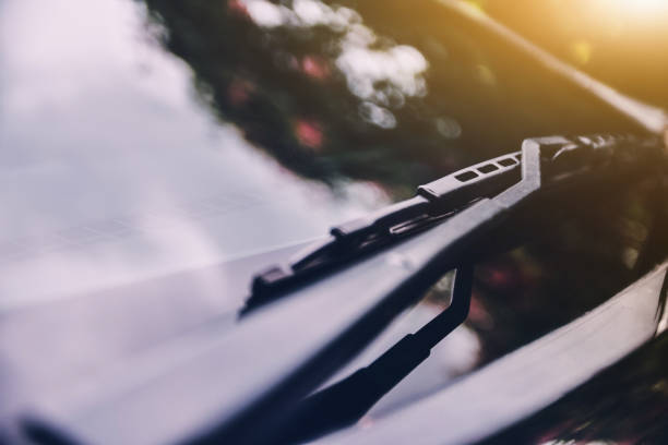 Car wiper of car parked on street sunlight background Car wiper of car parked on street sunlight background windshield wiper stock pictures, royalty-free photos & images