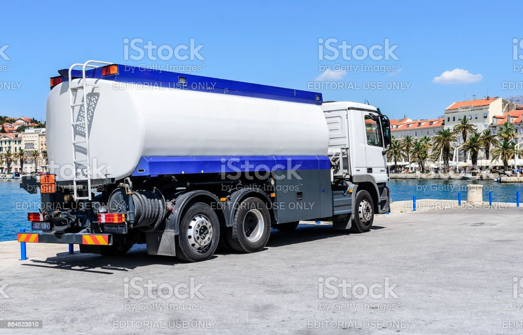 Car with a cistern on the seafront of Split. stock photo