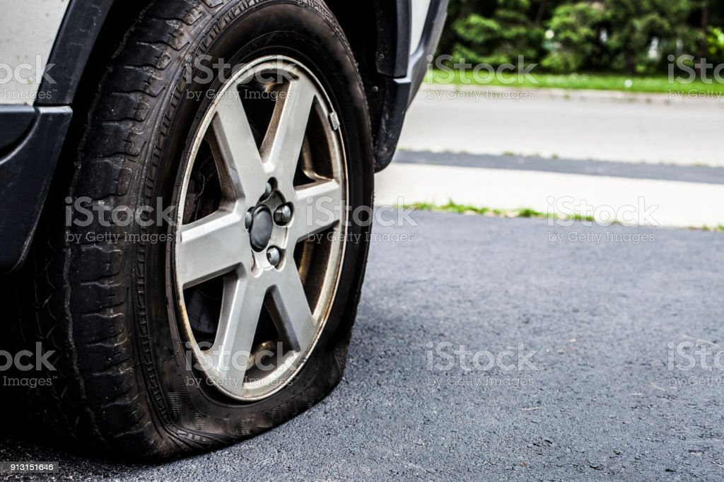 Car with a Flat Tire on the Road stock photo