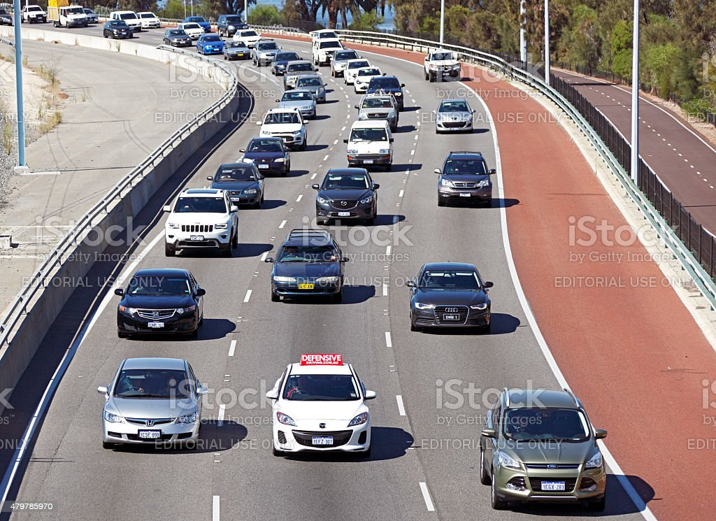 "Car with ""Defensive Driving"" advertising sign in freeway traffic stock photo"