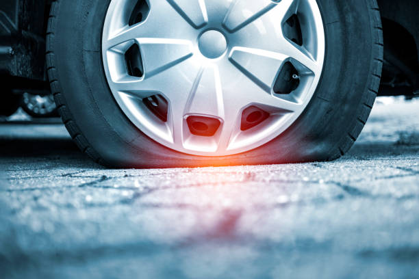 Car with flat tire stock photo