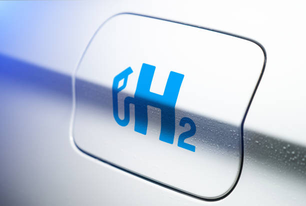 Car with hydrogen logo on filler cap. h2 combustion engine for emission free ecofriendly transport. stock photo