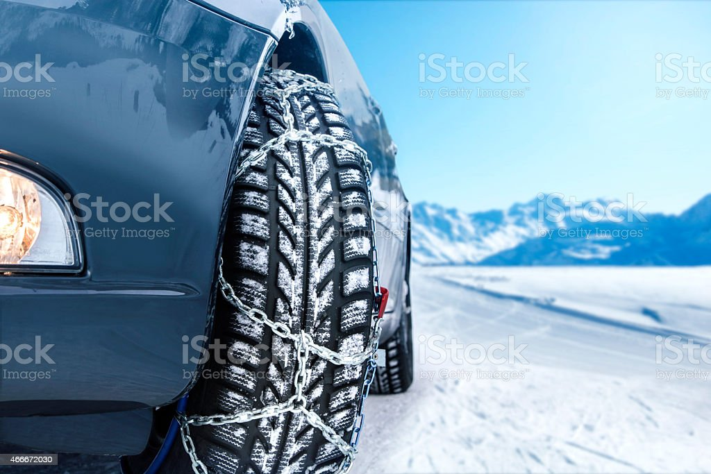 Car with mounted snow chains stock photo