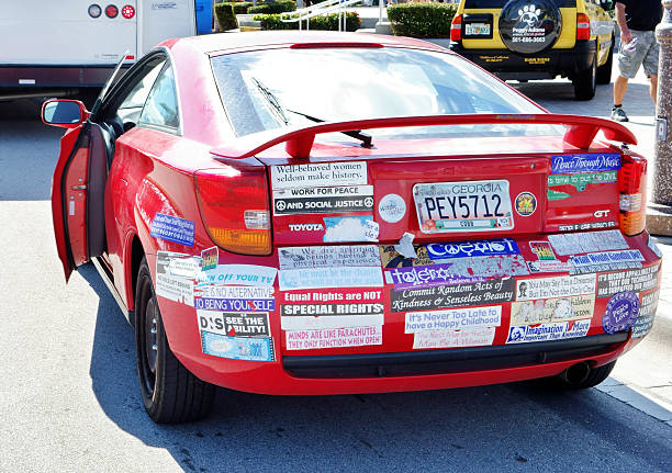 Car with socially responsible bumper stickers stock photo