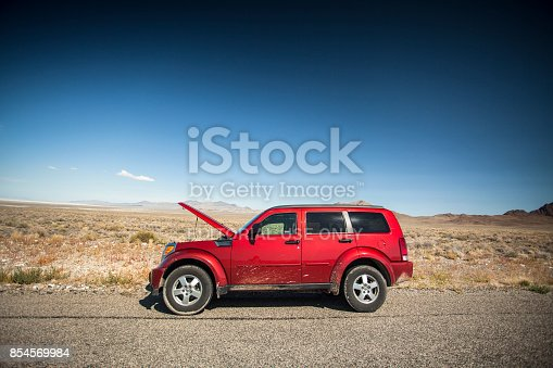 istock Car with the hood open on the side of the salt flats in Utah USA 854569984