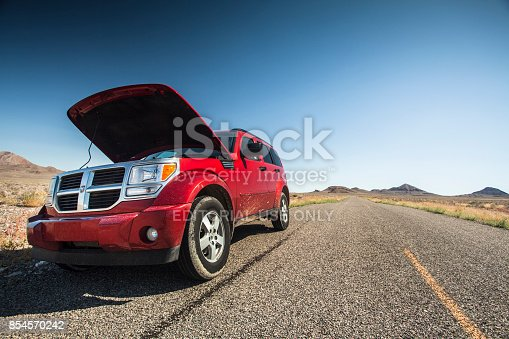 istock Car with the hood open on the side of the salt flats in Utah USA 854570242